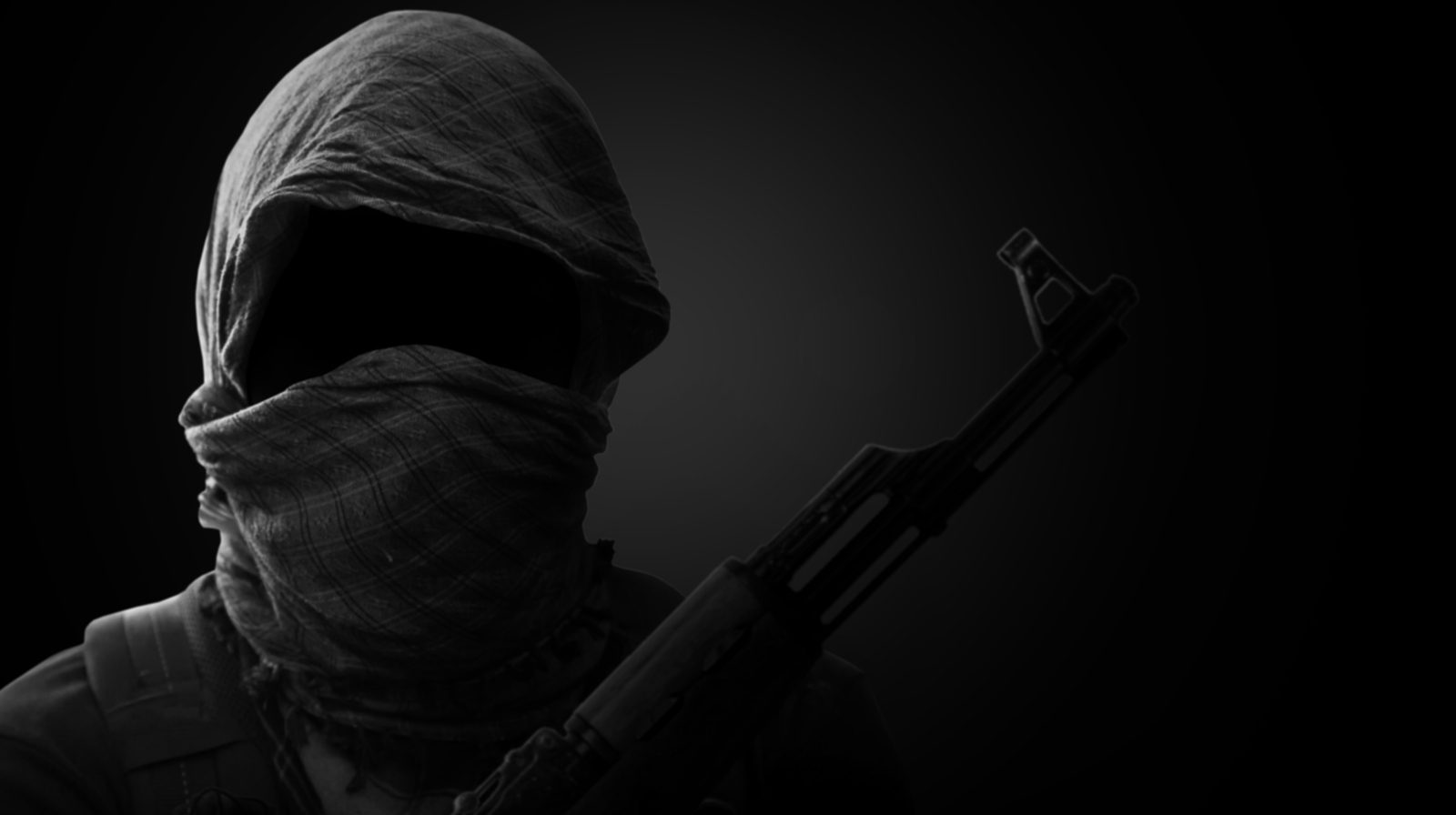 Blurry Background of Terrorist carry weapon hidden in darkness