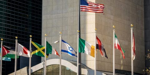 Flags of the world with the United States and Israel displayed prominently.
