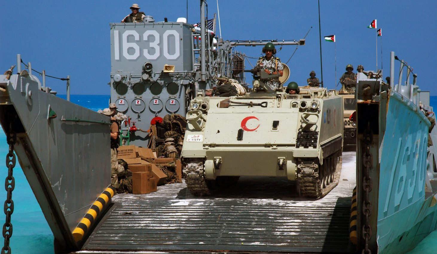 An Egyptian Army M113 Armored Personnel Carrier lead convoy of Royal Jordan Army Vehicles offloading from a US Navy (USN) Landing Craft Utility (LCU-1630) craft assigned to Assault Craft Unit One (ACU-1), on the beach at Mubarek Military City, Egypt, in preparation for an amphibious assault landing demonstration in support of Exercise BRIGHT STAR 2005. The exercise is an important part of US Central CommandÕs (USCENTCOM) theater engagement strategy and is designed to improve readiness, interoperability, strengthen the military and professional relationships among participating forces.