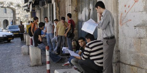 JERUSALEM JUNE 12: Group of young, male, Arab students stand inside the New Gate on Bab El-Jadid Street in Old City, Jerusalem, Israel, studying for their final graduation exams on June 12, 2007.