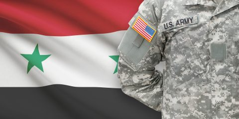 American soldier with flag on background - Syria