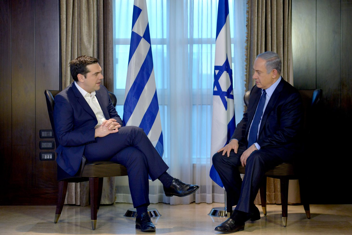 Prime Minister Benjamin Netanyahu and Prime Minister of Greece Alexis Tsipras speak at the King David Hotel in Jerusalem, during a government to government meeting.