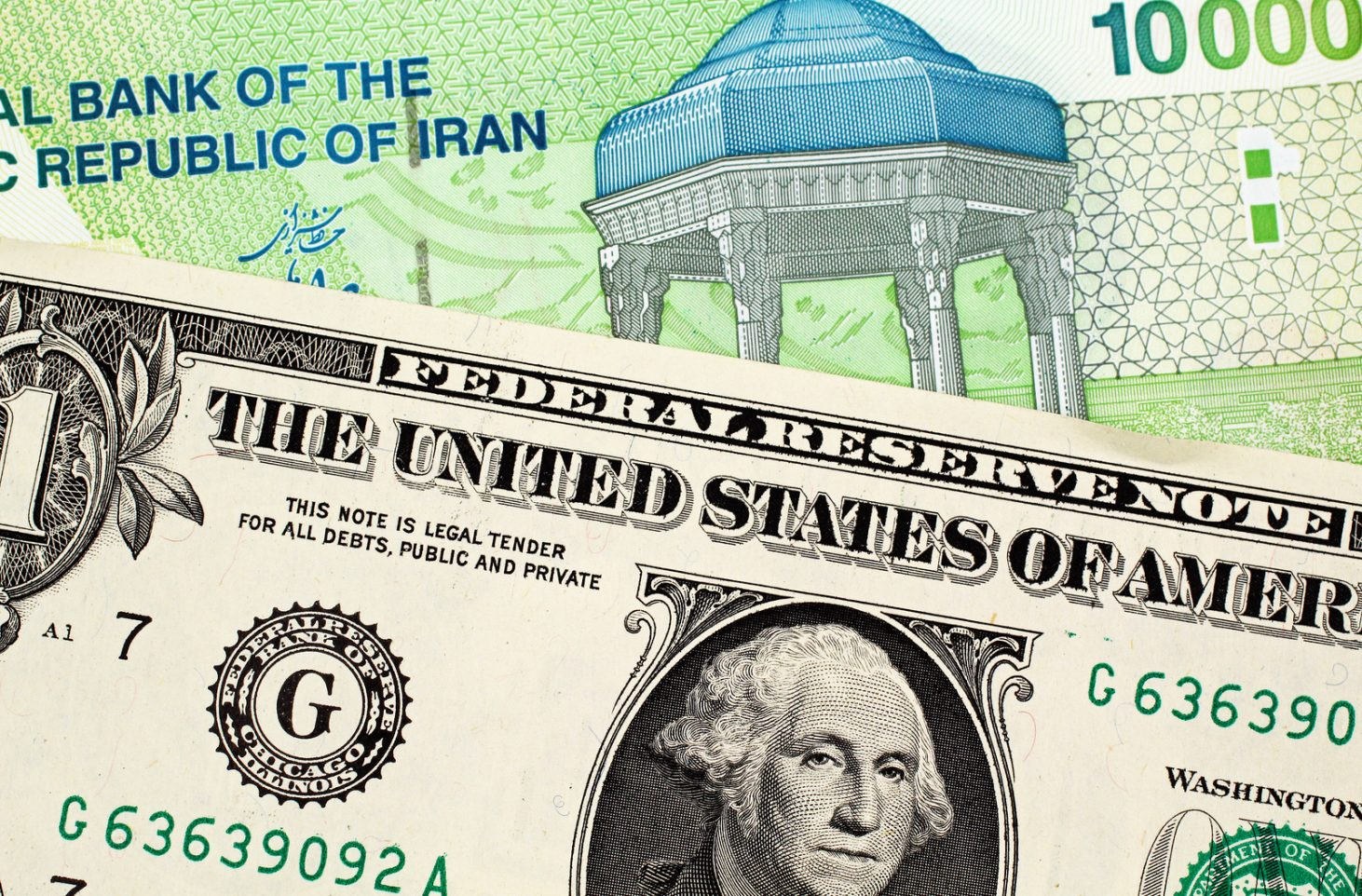 A Green 10000 Iranian Rial Note With An American One Dollar Bill