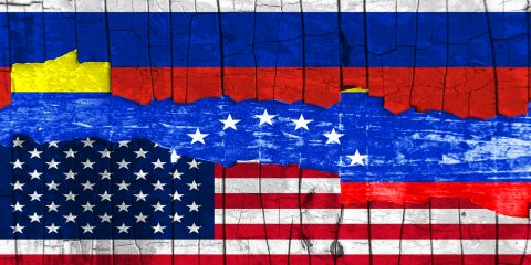 Flags of Venezuela, Russia and the USA on the background texture peeling paint with a crack. Horizontal frame