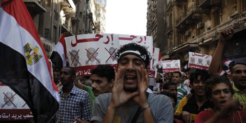 CAIRO - JUNE 30: Unidentified anti Muslim Brotherhood/Morsi protesters in Tahrir Square shout slogans calling for Morsi's resignation on June 30 2013 in Cairo Egypt.