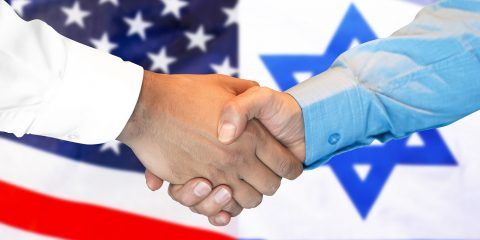 Business handshake on the background of two flags. Men handshake on the background of the United States of America and Israel flag. Support concept