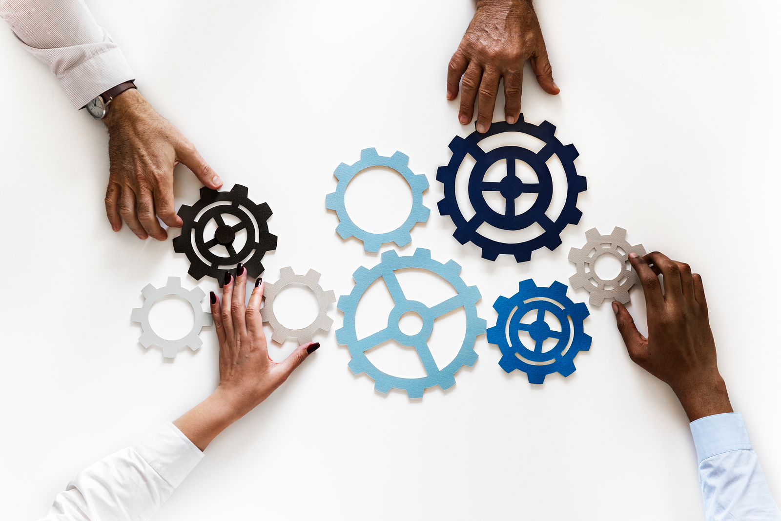 Hands with support gears isolated on white background
