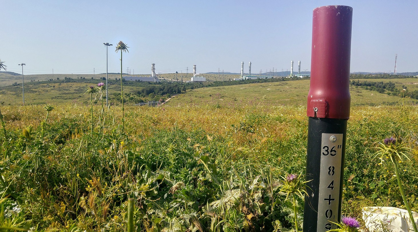 a_gas_pipeline_and_the_power_plant_in_the_background
