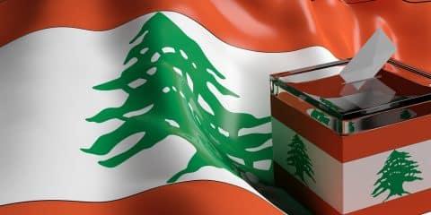 Glass ballot box on Lebanon flag background 3d illustration