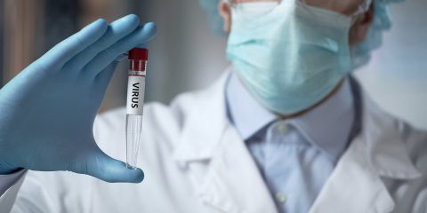 Lab Researcher Holding Virus Sample, Illegal Clinical Trials, Ge