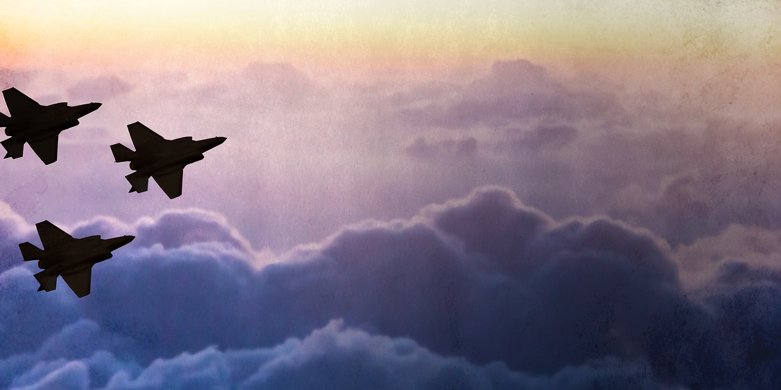 Silhouettes of three F-35 aircraft on sunset sky background
