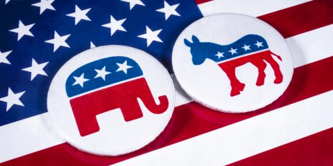 The Elephant symbol of the Republican Party and the Donkey symbol of the Democratic Party, with the American flag behind