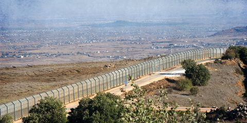 The fence of the border between Israel and Syria as seen from a hill on the Golan Heights about 10 kilometers south/south-east of the city Al Quneitra