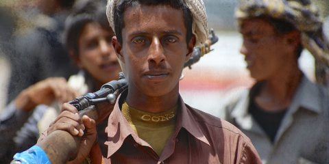 Unidentified young Yemeni man holds a rifle in Aden, Yemen.