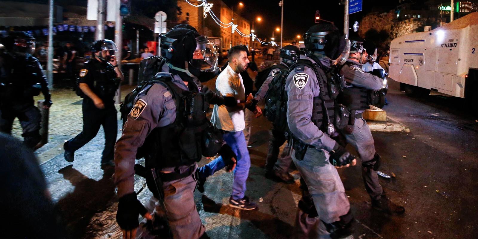 Israeli police arrest a Palestinian outside the Damascus Gate of Jerusalem s Old City