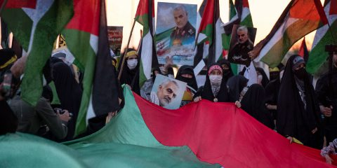 Pro-Palestinian Protests In Iran Iranian clergywomen hold a giant Palestinian flag and portraits of the Iranian former Islamic Revolutionary Guard Corps (IRGC) Quds Force General Qasem Soleimani