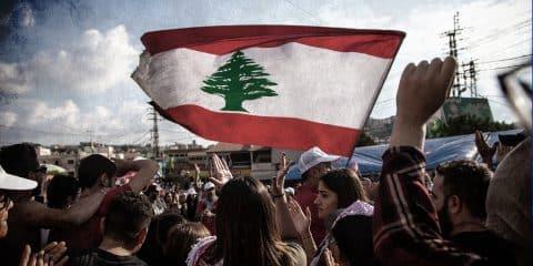 Lebanese Protesters rising Lebanon Flag